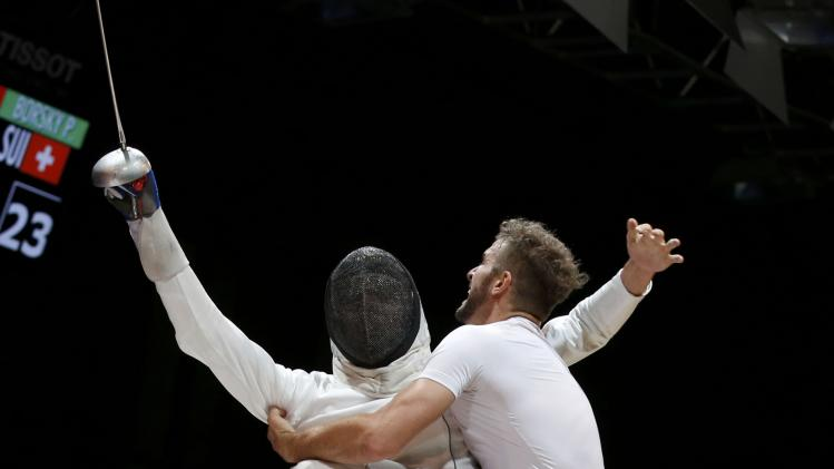 Borsky of Switzerland and teammates celebrate victory over Sukhov of Russia in the men's team epee third place match at the World Fencing Championships in Kazan