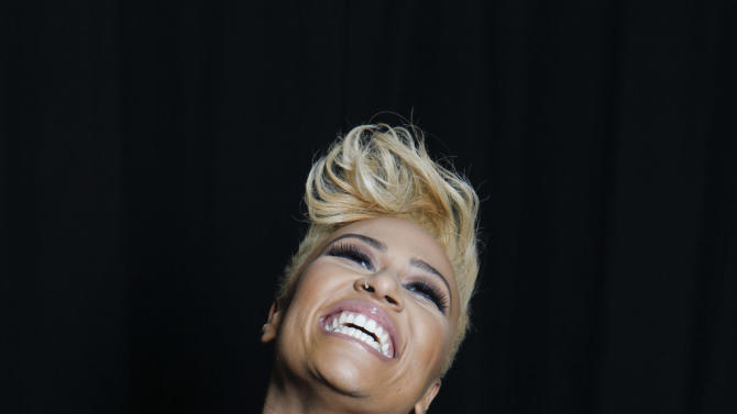 """In this April 25, 2012 file photo, Scottish soul and R&B recording artist Emeli Sandé poses for a portrait in New York. After penning songs for acts like Susan Boyle, Cheryl Cole and Tinie Tempah through a publishing deal, the singer said getting her own recording contract wasn't easy, mainly because record executives couldn't picture Sande as the artist behind the songs she was writing. She eventually found a home at a label that let her belt her pipes over R&B beats and pop grooves. """"Our Version of Events,"""" her debut, was released in June. (AP Photo/Amy Sussman, file)"""