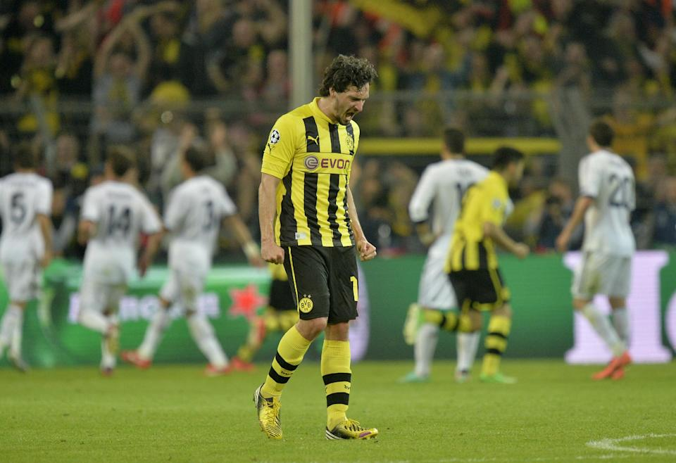 Dortmund's Mats Hummels reacts after his teammate Robert Lewandowski of Poland, unseen, scored their fourth goal during the Champions League semifinal first leg soccer match between Borussia Dortmund and Real Madrid in Dortmund, Germany, Wednesday, April 24, 2013. (AP Photo/Martin Meissner)