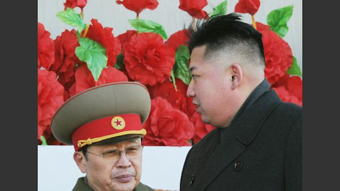 """FILE - In this Feb. 16, 2012 file photo, North Korean leader Kim Jong Un walks past his uncle Jang Song Thaek, left, after reviewing a parade of thousands of soldiers and commemorating the 70th birthday of the late Kim Jong Il in Pyongyang, North Korea. North Korean state media say Kim Jong Un's uncle has been executed, calling the leader's former mentor """"worse than a dog."""" The announcement on Thursday evening, Dec. 12, 2013, comes days after Pyongyang announced that Jang Song Thaek had been removed from all his posts because of allegations of corruption, drug use, gambling, womanizing and generally leading a """"dissolute and depraved life."""" (AP Photo/Kyodo News, File) JAPAN OUT, CREDIT MANDATORY"""