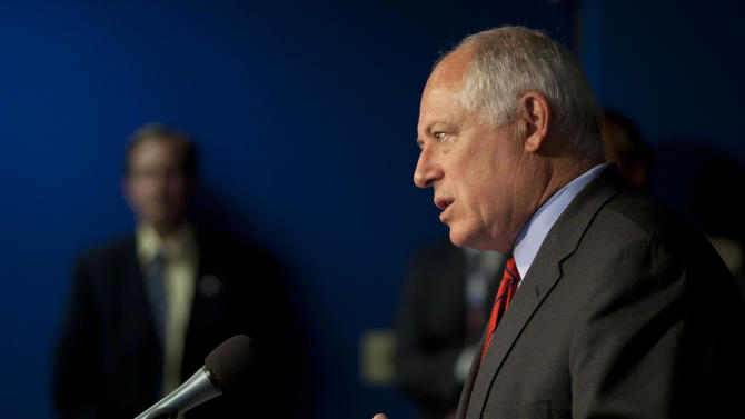 Illinois Gov. Pat Quinn speaks at a news conference on Wednesday, July 11, 2012, in Chicago, before he signed a bill ending the policy of letting lawmakers hand out college scholarships, a practice that has produced repeated accusations of misconduct. (AP Photo/Sitthixay Ditthavong)