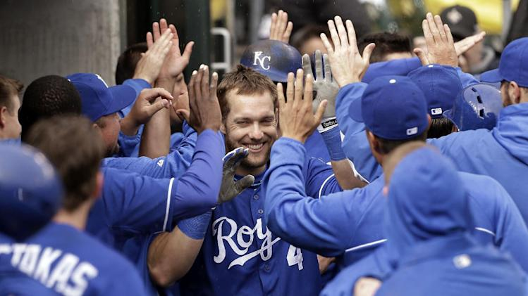 Kansas City Royals' Alex Gordon celebrates his grand slam against the Detroit Tigers in the 10th inning of a baseball game in Detroit, Thursday, April 25, 2013. (AP Photo/Paul Sancya)