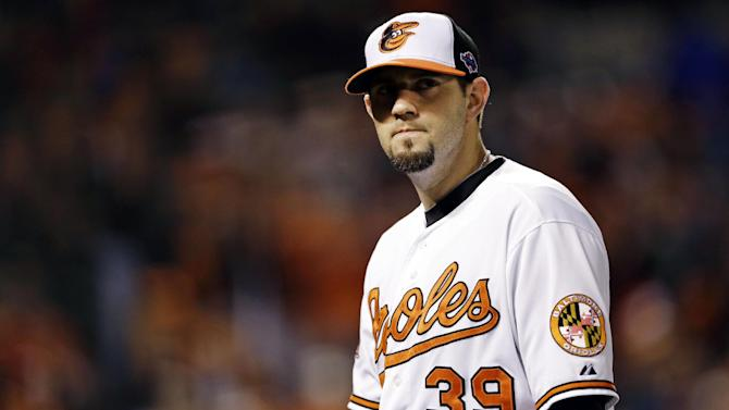 Baltimore Orioles starting pitcher Jason Hammel walks off the field after the first inning of Game 1 of the American League division baseball series against the New York Yankees, Sunday, Oct. 7, 2012, in Baltimore. (AP Photo/Patrick Semansky)