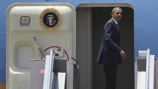 U.S. President Barack Obama boards Air Force One as he departs the Ninoy Aquino International Airport in Manila, the Philippines Tuesday, April 29, 2014. The Philippines is the last leg of Obama's four-nation Asia tour. (AP Photo/Aaron Favila)