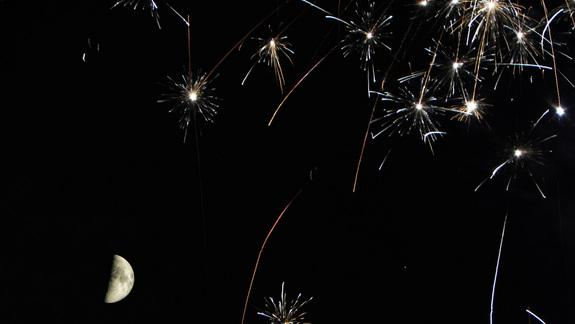 Fireworks and the Moon Dazzle in Spectacular Photo