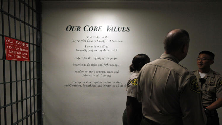 "The Los Angeles County Sheriff's Department's ""Core Values"" are displayed on a wall at the Men's Central Jail in downtown Los Angeles Wednesday, Oct. 3, 2012. Los Angeles County Sheriff Lee Baca says he plans to implement all the reforms suggested by a commission in the wake of allegations that a culture of violence flourished in his jails. (AP Photo/Reed Saxon)"