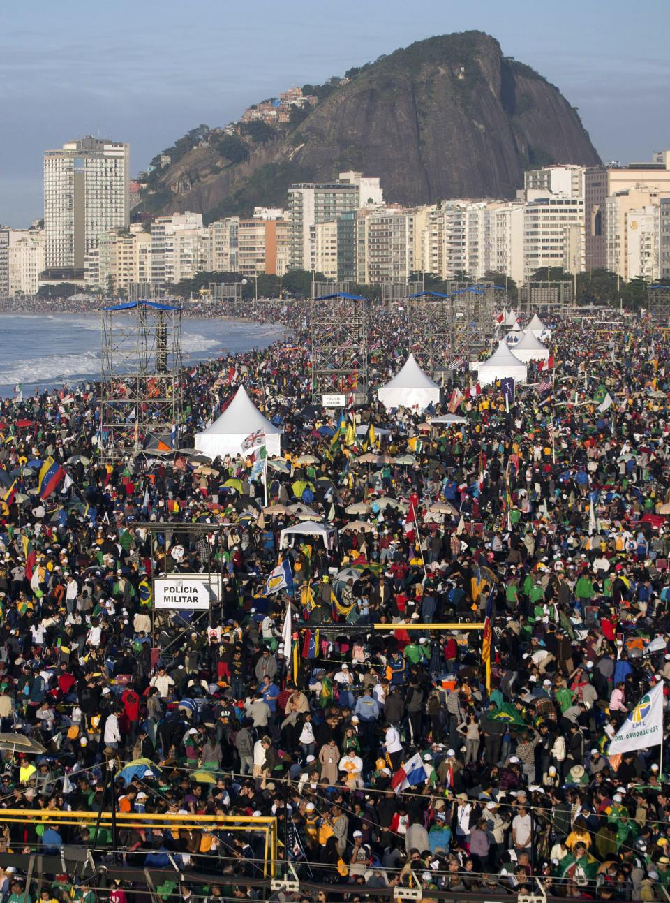 Pilgrims pack Copacabana beach in Rio de Janeiro, Brazil, Sunday, July 28, 2013. Hundreds of thousands of young people slept under chilly skies in the white sand awaiting Pope Francis' final Mass for World Youth Day.(AP Photo/Victor R. Caivano)