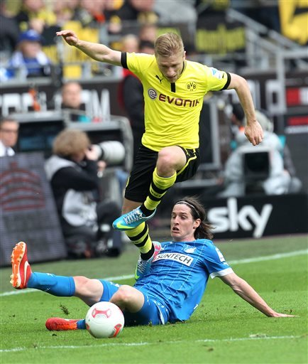 Borussia Dortmund's Jakub Blaszczykowski of Poland, leaps over the sliding challenge from TSG 1899 Hoffenheim's Sebastian Rudy during a German first division Bundesliga soccer match in Dortmund, Germa