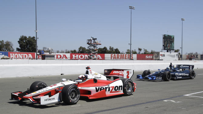 Juan Pablo Montoya (2), of Colombia, followed by Ryan Briscoe (8), of Australia, heads onto the track for practice for the IndyCar auto race Saturday, Aug. 23, 2014, in Sonoma, Calif. (AP Photo/Eric Risberg)