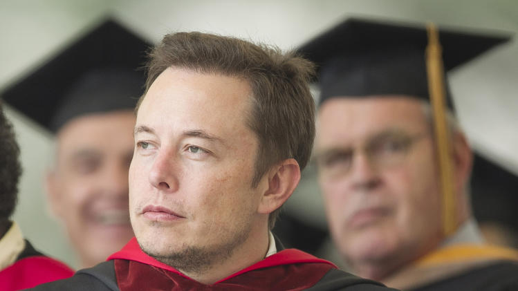 SpaceX CEO and Chief Designer Elon Musk pauses during his commencement speech for Caltech graduates in Pasadena, Calif. Friday, June 15, 2012. (AP Photo/Damian Dovarganes)