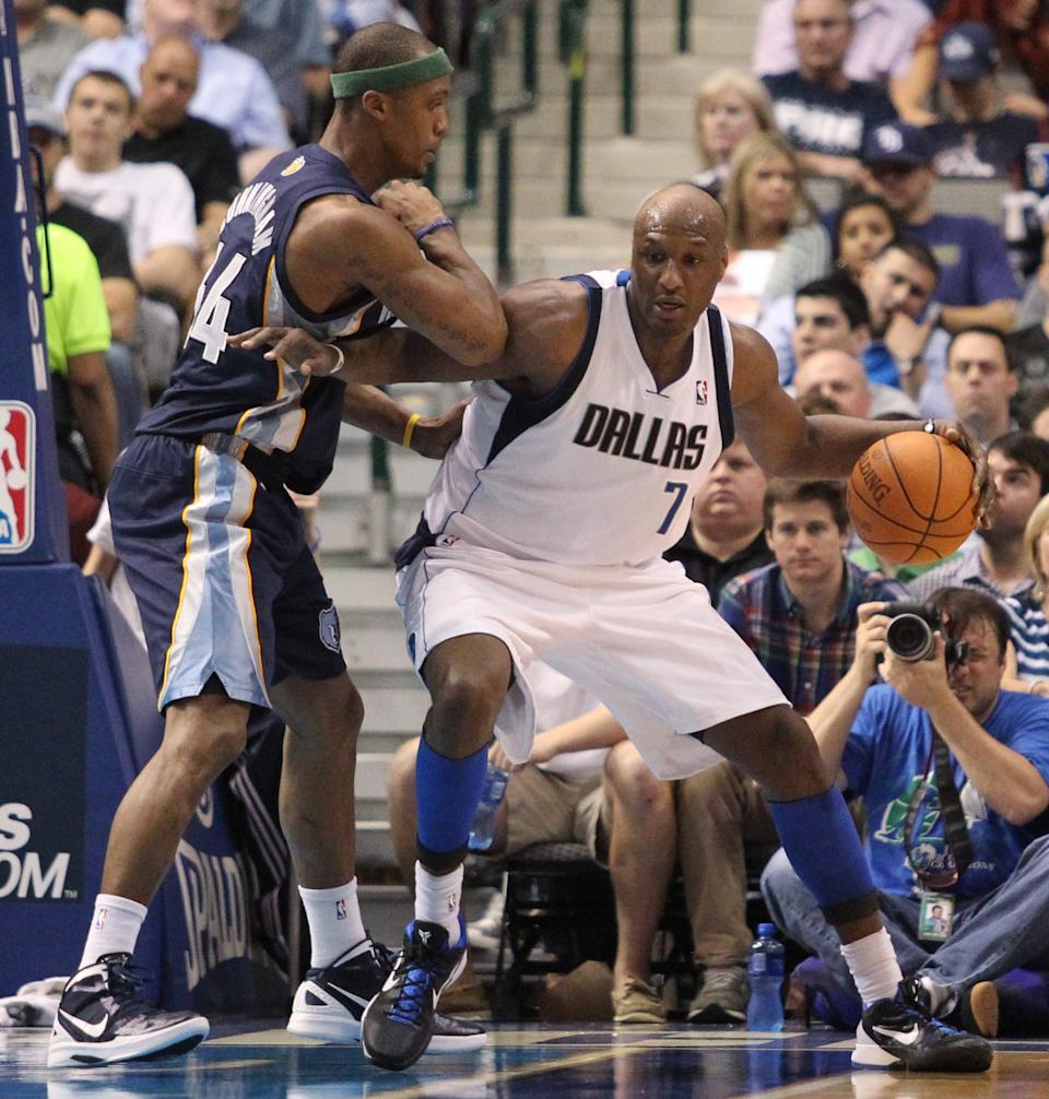 Dallas Mavericks forward Lamar Odom (7) works against Memphis Grizzlies forward Dante Cunningham during the second half of an NBA basketball game in Dallas on Wednesday, April 4, 2012. Dallas won 95-85. (AP Photo/Mike Fuentes)