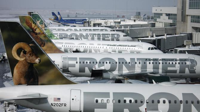FILE - In this Monday, Feb. 22, 2010, file photo, Frontier Airlines jetliners sit stacked up at gates along the A concourse at Denver International Airport. Carriers are offering more deals to passengers who book flights directly on their websites. Frontier Airlines is the latest carrier to jump into the fight, announcing Wednesday, Sept. 12, 2012, that it will penalize passengers who don't book directly with the airline. (AP Photo/David Zalubowski, File)