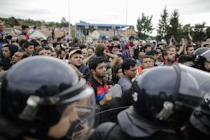 Refugees wait to cross the border after most of them…