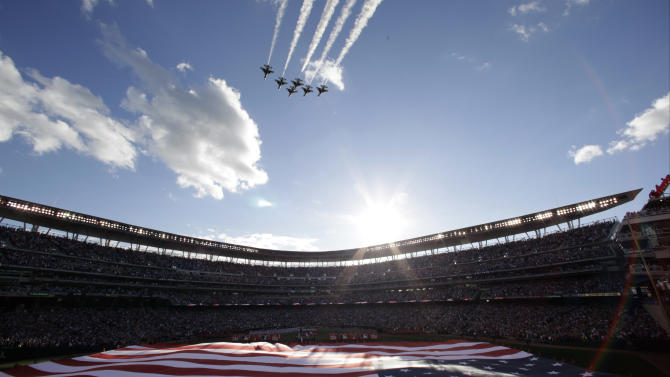 The U.S. national anthem is played before the MLB All-Star baseball game, Tuesday, July 15, 2014, in Minneapolis. (AP Photo/Paul Sancya)