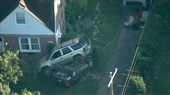 SUV and van land on top of each other in Bustleton crash