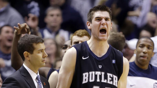 Butler center Andrew Smith (44) celebrates next to head coach Brad Stevens during the overtime period an NCAA college basketball game against Indiana in Indianapolis, Saturday, Dec. 15, 2012. Butler defeated No. 1 Indiana 88-86 in overtime. (AP Photo/Michael Conroy)