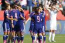 Japan players celebrate a 2-1 win as England's Ellen White (23) watches following a semifinal in the FIFA Women's World Cup soccer tournament, Wednesday, July 1, 2015, in Edmonton, Alberta, Canada. Japan won 2-1. (Jeff McIntosh/The Canadian Press via AP)
