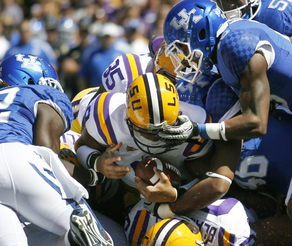 LSU quarterback Jordan Jefferson (9) sneaks into the end zone to score a touchdown with his first snap from center after being reinstated to the team during the first half of an NCAA college football game against Kentucky, in Baton Rouge,  La., Saturday, Oct. 1, 2011. (AP Photo/Gerald Herbert)
