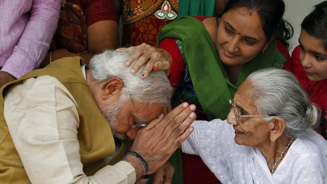 Hindu nationalist Modi, prime ministerial candidate for India's main opposition BJP, seeks blessings from his mother Heeraben at her residence in Gandhinagar