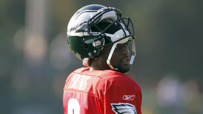 Philadelphia Eagles quarterback Vince Young looks over his shoulder as he walks on the field before an NFL football training camp practice at Lehigh University Friday, Aug. 5, 2011 in Bethlehem, Pa. (AP Photo/Alex Brandon)