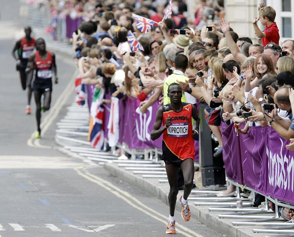 Gold-medalist Stephen Kiprotich of Uganda competes in the men's marathon at the 2012 Summer Olympics, Sunday, Aug. 12, 2012, in London. (AP Photo/Mike Groll)