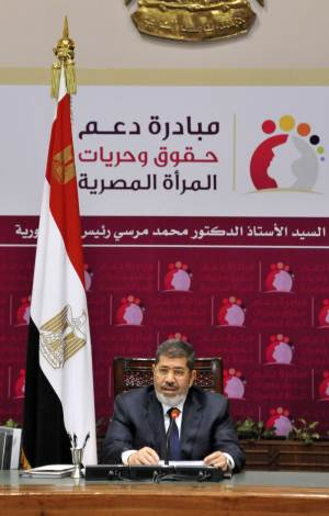 "In this image released by the Egyptian Presidency, Egyptian President Mohammed Morsi speaks at a conference on women's rights held at the Presidential palace in Cairo, Egypt, Sunday, March 24, 2013. Egypt's president delivered a stern warning to his opponents on Sunday, saying he may be close to taking unspecified measures to ""protect this nation"" two days after supporters of his Muslim Brotherhood and opposition protesters fought street battles in the worst bout of political violence in three months. (AP Photo/Egyptian Presidency)"