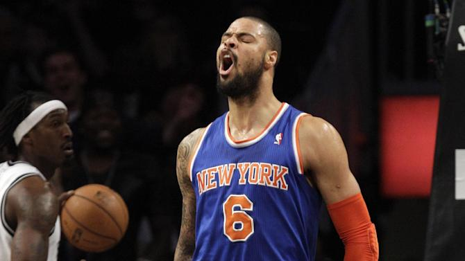 New York Knicks center Tyson Chandler (6) reacts after dunking as Brooklyn Nets forward Gerald Wallace, far left, watches in the first half of their NBA basketball game, at Barclays Center, Monday, Nov. 26, 2012, in New York. (AP Photo/Kathy Willens)
