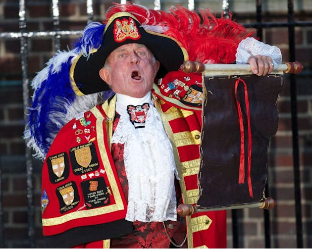 A town crier reads an announcement about the royal baby outside the Lindo Wing in London, on July 22, 2013