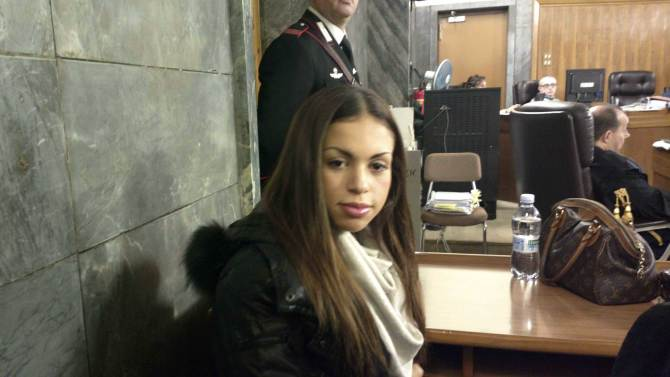 Karima el-Mahroug, the Moroccan woman at the center of ex-Premier Silvio Berlusconi's sex-for-hire trial, sits in a court room prior to to testifying as a witness for the first time, in Milan, Monday, Jan. 14, 2013. El-Mahroug was ordered by the court to appear Monday to testify after failing to show on two previous dates because she was reportedly in Mexico on vacation. She has been called as a defense witness. Berlusconi is accused of paying for sex with woman, better known as Ruby, when she was 17, and then trying to cover it up. Both deny sexual contact. (AP Photo/Luca Bruno)