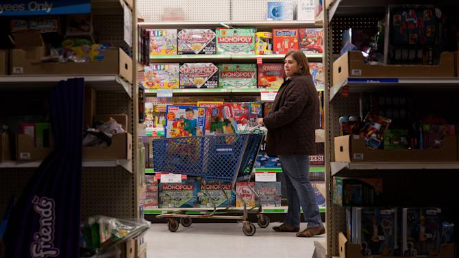 "A customer examines shelves of toys during Toys ""R"" Us' Black Friday sales event in Flint, Mich. on Thursday, Nov. 22, 2012. (AP Photo/Flint Journal, Griffin Moores)"