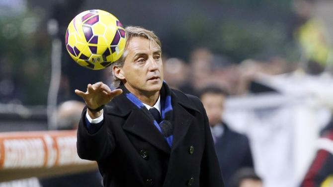 Inter Milan's coach  Mancini throws  the ball during their Italian Serie A soccer match against AC Milan in Milan