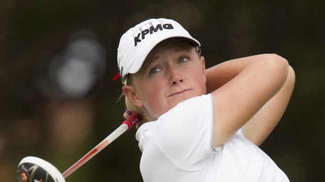 Stacy Lewis, of Texas, watches her drive off the first tee in the third round of the LPGA Lotte Championship golf tournament at Ko Olina Golf Club, Friday, April 19, 2013, in Kapolei, Hawaii. (AP Photo/Eugene Tanner)