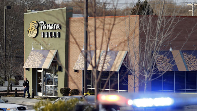 An investigator walks at the scene of a shooting at a shopping center in Abingdon, Md., Wednesday, Feb. 10, 2016. A man opened fire inside the crowded restaurant during lunchtime. (AP Photo/Patrick Semansky)