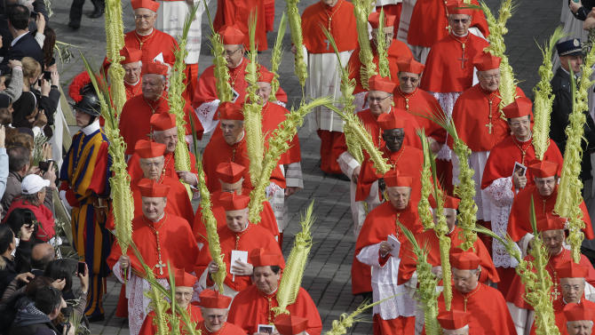 Cardinals arrive to attend Palm Sunday Mass, in St. Peter's Square at the Vatican, Sunday, March 24, 2013. Pope Francis celebrated his first Palm Sunday Mass in St. Peter's Square, encouraging people to be humble and young at heart, as tens of thousands joyfully waved olive branches and palm fronds. The square overflowed with some 250,000 pilgrims, tourists and Romans eager to join the new pope at the start of solemn Holy Week ceremonies, which lead up to Easter, Christianity's most important day. (AP Photo/Alessandra Tarantino)