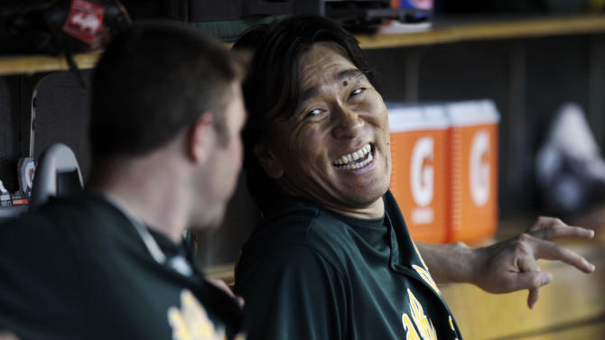 Oakland Athletics' Hideki Matsui laughs with Landon Powell after hitting a solo home run against the Detroit Tigers in the sixth inning of a baseball game in Detroit, Wednesday, July 20, 2011. (AP Photo/Paul Sancya)