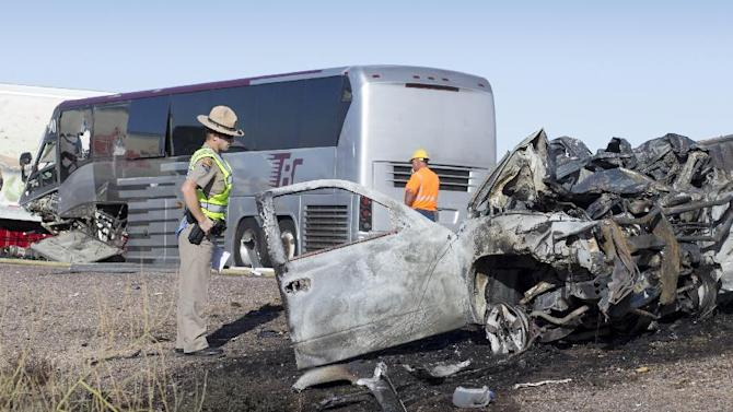 """A wrong-way pickup truck driver was killed on Interstate 10 Tuesday, Nov. 20, 2012 when the vehicle collided head-on with a tour bus, forcing the closure of all westbound lanes near Casa Grande, Ariz., authorities said.  The collision also involved a semi-truck, state Department of Public Safety officials said.  DPS spokesman Bart Graves reported """"numerous"""" injuries among the 16 people aboard the bus. Among the most seriously hurt was the driver of the bus, Graves said. (AP Photo/The Arizona Republic, Mark Henle)"""