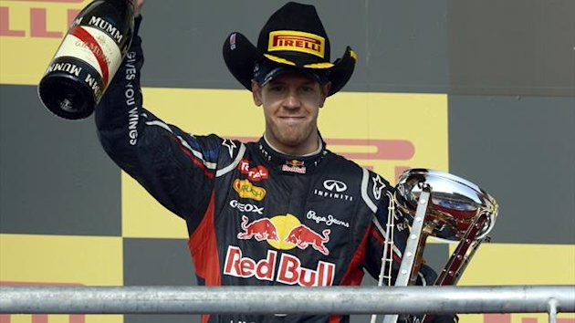 Red Bull Racing driver Sebastian Vettel of Germany clebrates on the podium after his second place finish at the United States Formula One Grand Prix at the Circuit of the Americas (AFP)