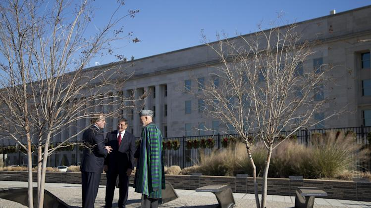 Afghan President Hamid Karzai, right, and Defense Secretary Leon Panetta, center, get a tour National 9/11 Pentagon Memorial by James Laychak, president of the Pentagon Memorial Fund, Thursday, Jan. 10, 2013, at the Pentagon. (AP Photo/ Evan Vucci)