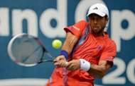 Fernando Verdasco of Spain plays a shot against Tatsuma Ito of Japan during their men's singles first round match at the ATP Thailand Open tennis tournament in Bangkok. Verdasco offered words of sympathy for injured fellow Spaniard Rafael Nadal Tuesday after surviving a scare to reach the ATP Thailand Open second round