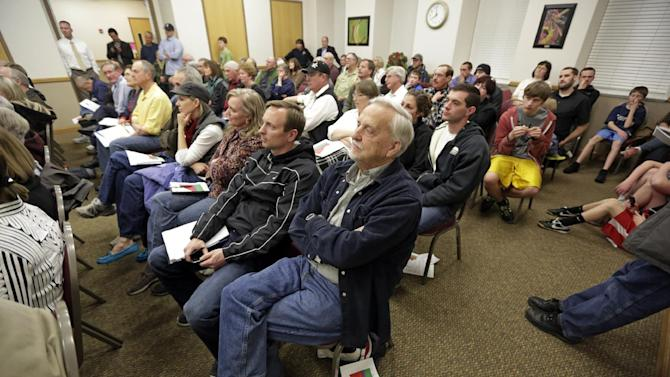 In this Feb. 7, 2013 photo, Robert Wren, center, listens as Rep. Jason Chaffetz, R-Utah, speaks during a town hall meeting in Heber City, Utah. Chaffetz flew home from Washington last week to attend the town hall meeting. Many voters here and in similar communities elsewhere still want to do whatever it takes to stop President Obama, and the politicians they elect are listening. (AP Photo/Rick Bowmer)