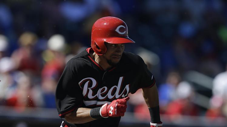 Cincinnati Reds' Billy Hamilton in action during a spring exhibition baseball game against the Texas Rangers Monday, March 10, 2014, in Suprise, Ariz. (AP Photo/Darron Cummings)