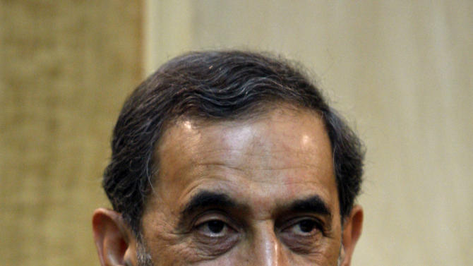 In this photo taken on Thursday, April 22, 2010, Iranian presidential hopeful, Ali Akbar Velayati, adviser to the Iranian supreme leader Ayatollah Ali Khamenei, looks on, at the Mehrabad airport, in Tehran, Iran. For eight years, Iran's President Mahmoud Ahmadinejad has played the role of global provocateur-in-chief: questioning the Holocaust, saying Israel should be erased from the map and painting U.N resolutions as worthless. Now, a race is beginning to choose his successor -- candidate registration starts Tuesday for a June 14 vote -- and it looks like an anti-Ahmadinejad referendum is shaping up. (AP Photo/Vahid Salemi)