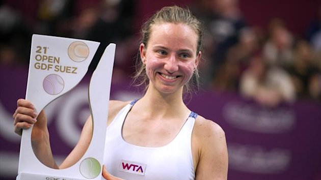 : Germany's Mona Barthel celebrates with her trophy after winning the Paris WTA tennis tournament final match against Italy's Sara Errani