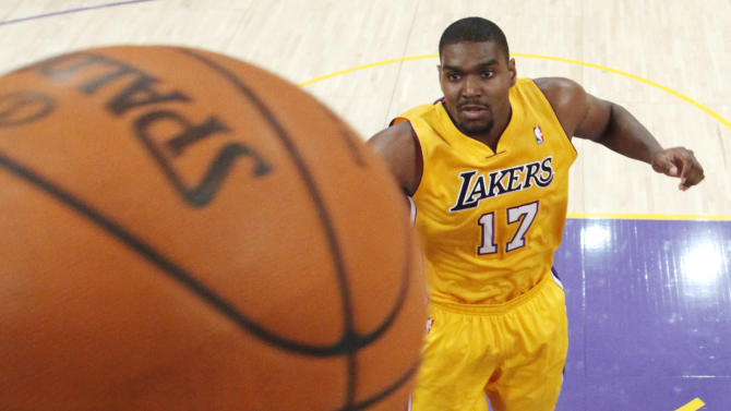 Los Angeles Clippers' Blake Griffin shoots the ball as Los Angeles Lakers' Andrew Bynum looks on during the first half of an NBA preseason basketball game in Los Angeles on Monday, Dec. 19, 2010. (AP Photo/Danny Moloshok)