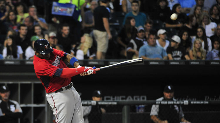 Minnesota Twins' Kennys Vargas hits an RBI double against the Chicago White Sox during the third inning of a baseball game, Friday, Aug. 1, 2014, in Chicago. It was Vargas' first hit in the majors. (AP Photo/David Banks)