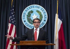 Texas Governor Rick Perry denounces felony charges by a Travis County grand jury during a press conference at the State Capitol in Austin Texas