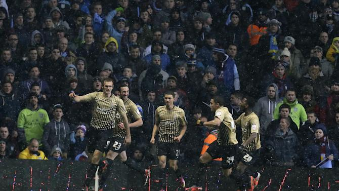 Bradford City' James Hanson, left, celebrates with teammates after scoring a goal against Aston Villa during their English League Cup second leg semi-final soccer match at Villa's stadium in Birmingham, England, Tuesday, Jan. 22, 2013.(AP Photo/Alastair Grant)