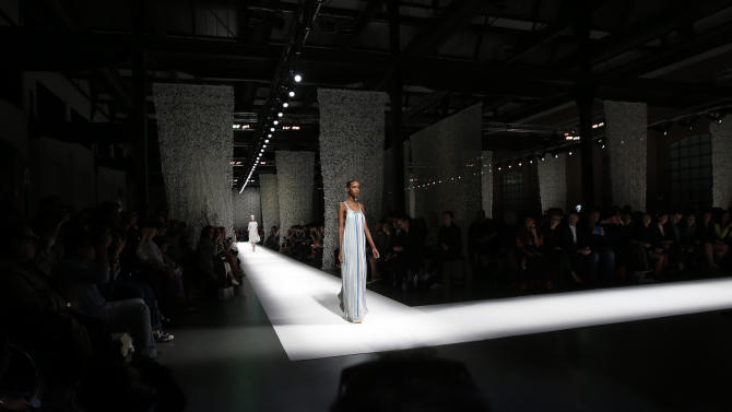 A model wears a creation for Missoni women's spring-summer 2015 collection, part of the Milan Fashion Week, unveiled in Milan, Italy, Friday, Sept. 19, 2014. (AP Photo/Luca Bruno)