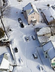 Neighborhoods and cars are buried in snow near New Haven, Conn., Sunday, Feb. 10, 2013, in the aftermath of a storm that hit Connecticut and much of the New England states. (AP Photo/Craig Ruttle)