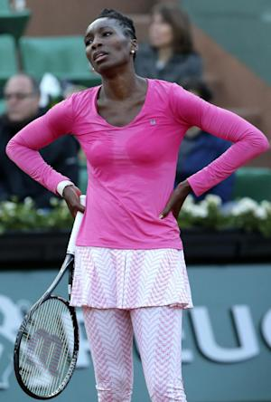 FILE - In this May 26, 2013, file photo, Venus Williams, of the United States, reacts after missing a return against Poland's Urszula Radwanska in their first round match of the French Open tennis tournament at Roland Garros stadium in Paris. Williams has pulled out of Wilmbledon because of a lower baback, her agent Carlos Fleming said, Tuesday, June 18, 2013. Williams, who turned 33 on Monday, was bothered by her back during a first-round loss at the French Open last month, (AP Photo/Michel Euler, File)